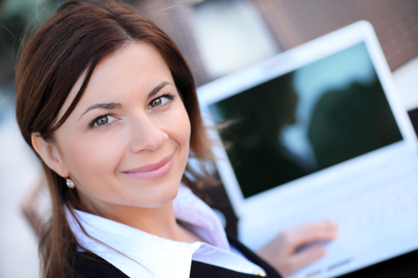 Beautiful business woman with laptop.